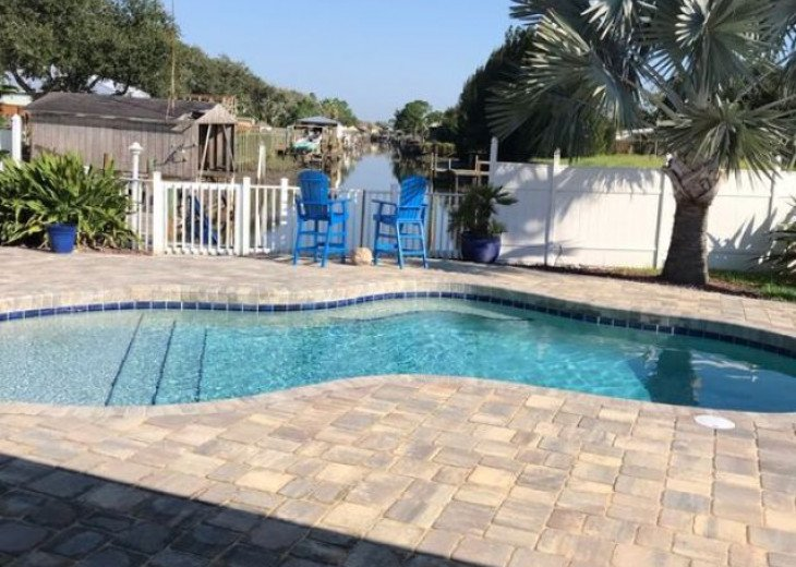 Beautiful private pool overlooking waterway with a boat dock for your use
