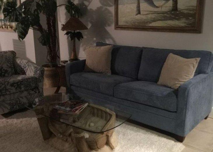 Living room with sleeper sofa and swivel rocker