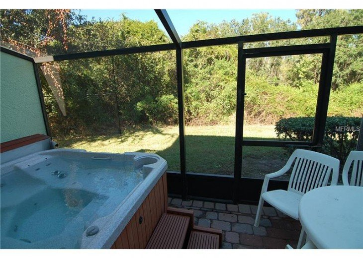screened patio with private hot tub.
