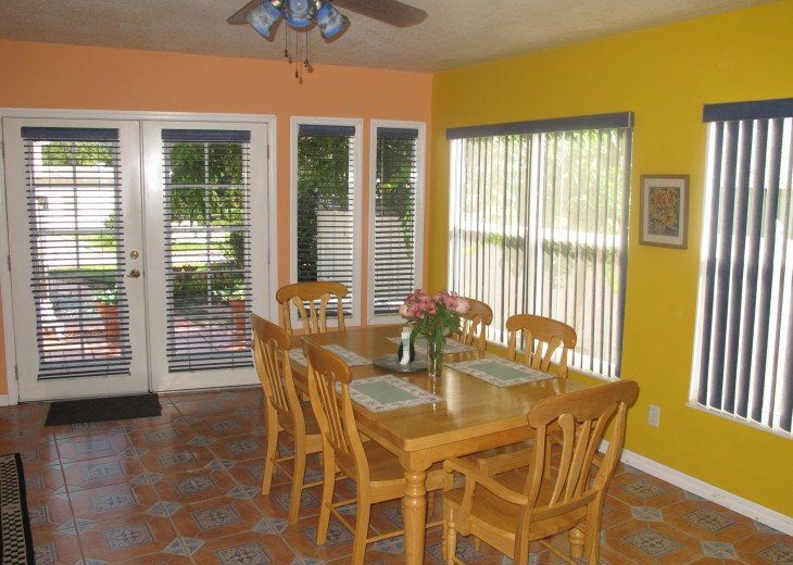 Sunny dining area with Tuscan style kitchen table that seats 6.