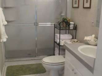 Spacious bathroom with shower and plush hotel style towels