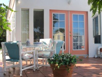 Enjoy dining outside in the warm Florida sun or evenings with a glass of wine