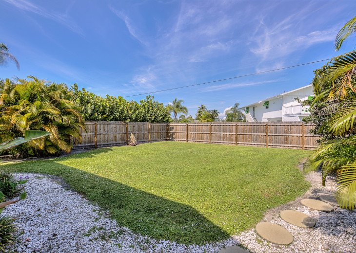 The private fenced yard safe for you family and pets to play