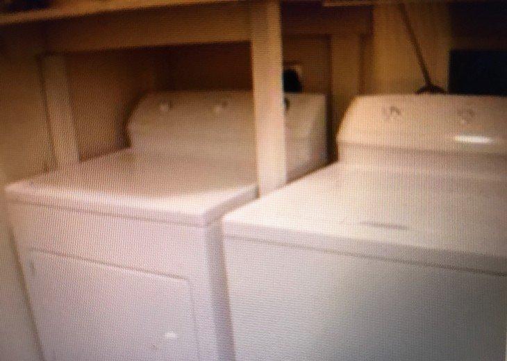 Laundry room in condo