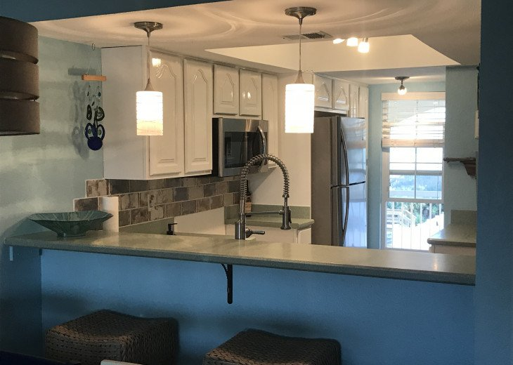 Bright kitchen with a tranquil beach view.