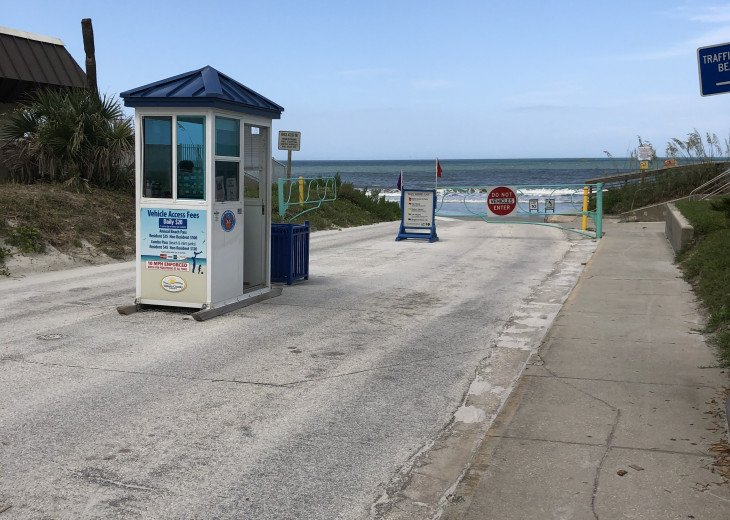 Entrance to Drive Beach handicap chairs available at Beach Patrol