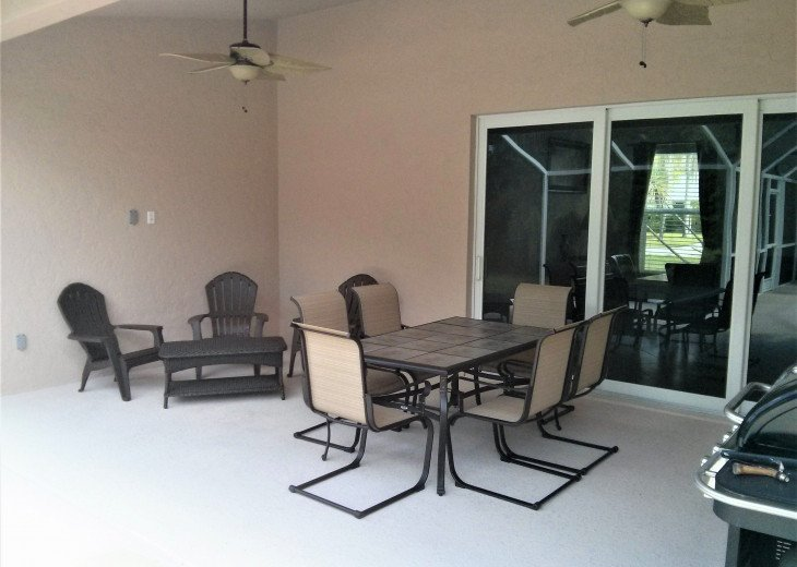 Enjoy the Florida sunshine! Large pool area to dine, entertain or just chill. #21