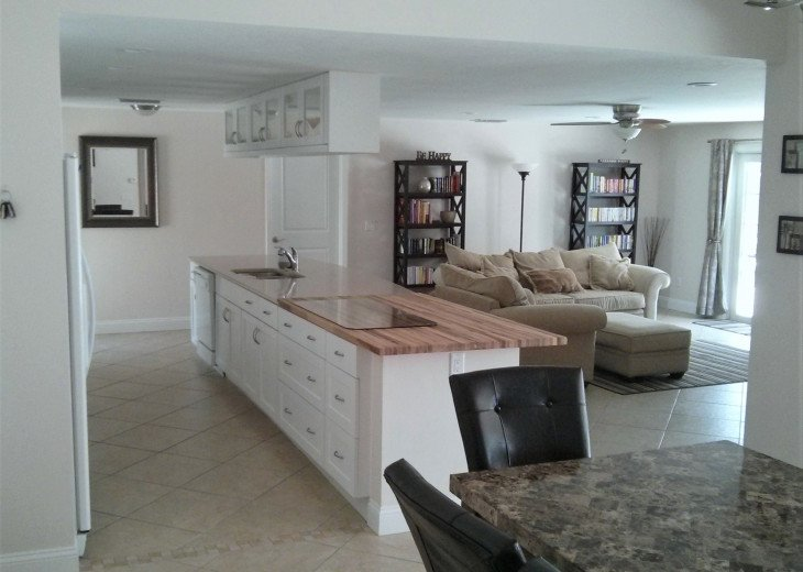 Enjoy the Florida sunshine! Large pool area to dine, entertain or just chill. #4