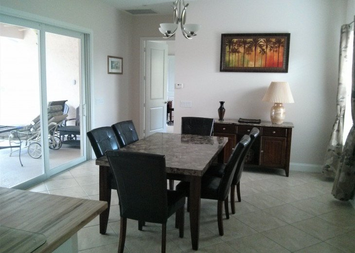 Enjoy the Florida sunshine! Large pool area to dine, entertain or just chill. #6