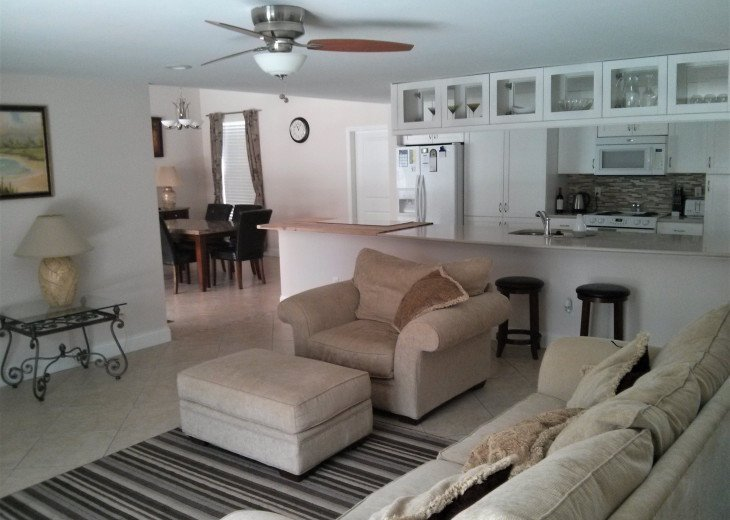 Enjoy the Florida sunshine! Large pool area to dine, entertain or just chill. #9