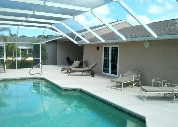 Enjoy the Florida sunshine! Large pool area to dine, entertain or just chill. #22