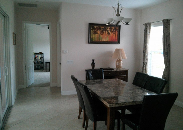 Enjoy the Florida sunshine! Large pool area to dine, entertain or just chill. #7