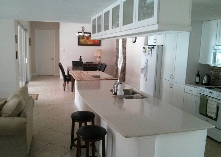 Enjoy the Florida sunshine! Large pool area to dine, entertain or just chill. #5
