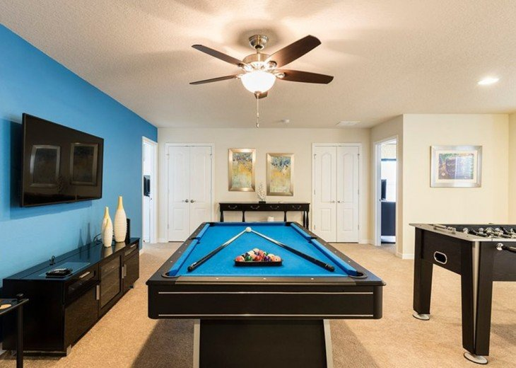 Pool table, foosball table and wet bar with seats