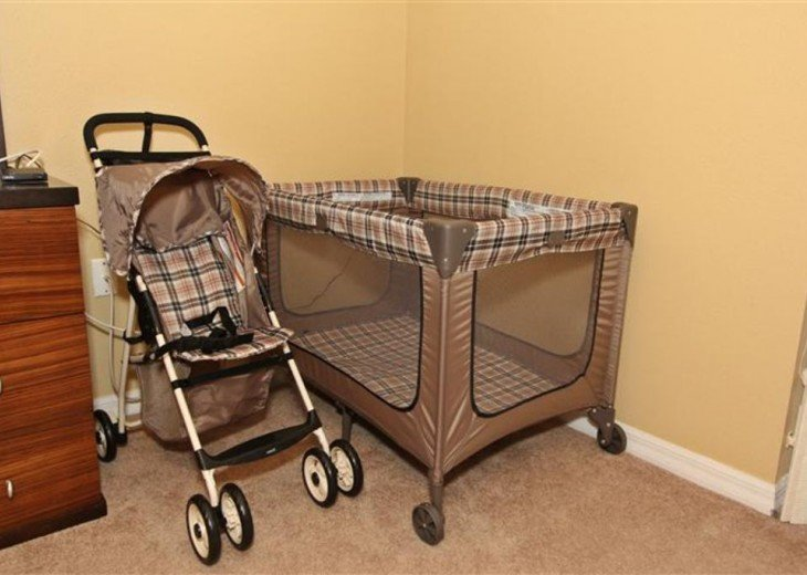Baby crib, high chair and a stroller .