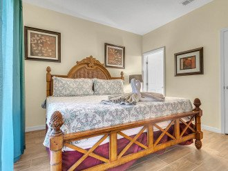 Master bedroom with king bed and inside bathroom