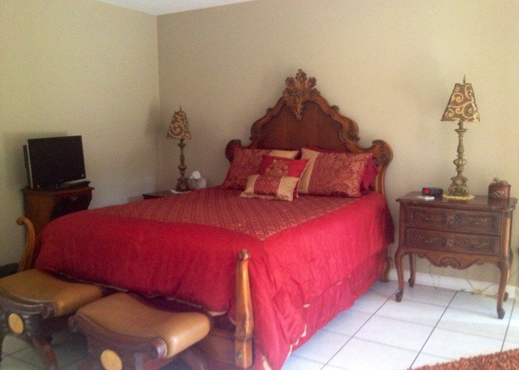 Master Bedroom leading to outdoor patio/pool.