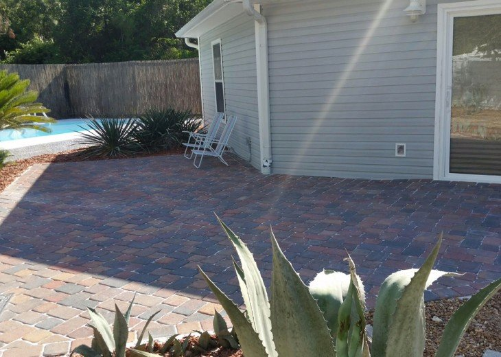 Patio to pool with gas grill.