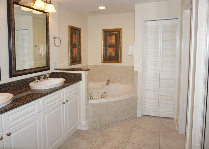 Master bath, jetted tub, walk in shower, toilet room