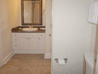 Private bathroom connected to Queen bedroom, tub/shower combo