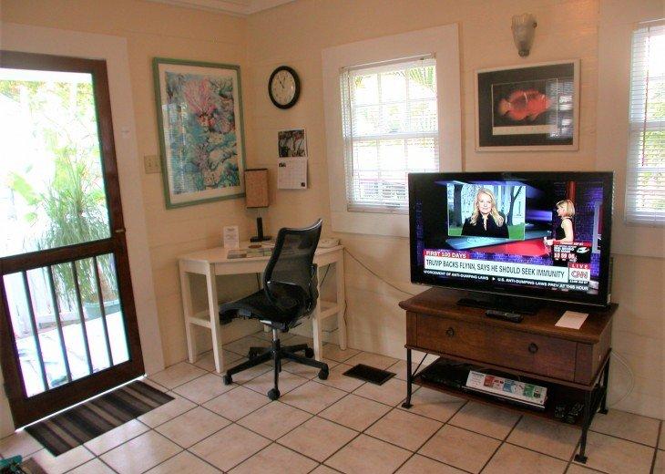 Living room computer desk, WiFi TV, DVD player.