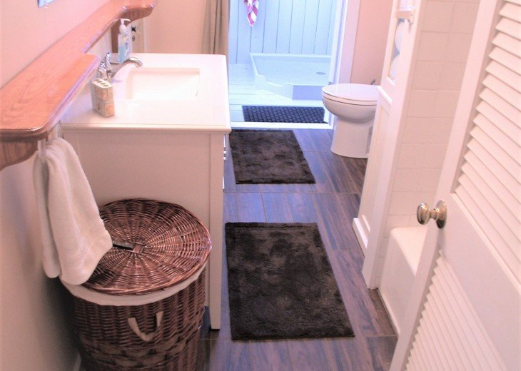 Bathroom includes tub and shower; French doors to outside shower