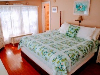 King Bed, TV, DVD player in bedroom. Separate doors to bath and kitchen.