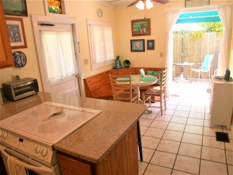 Kitchen breakfast bar, sit-down dining table, French doors to back deck