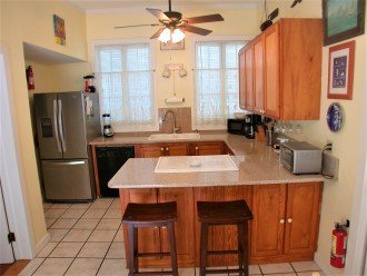 Fully equipped kitchen with major and minor appliances.