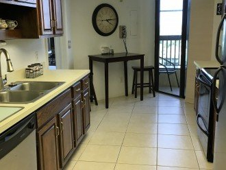 Kitchen has stainless steel appliances. Side by side refrig. new w/ ice maker.