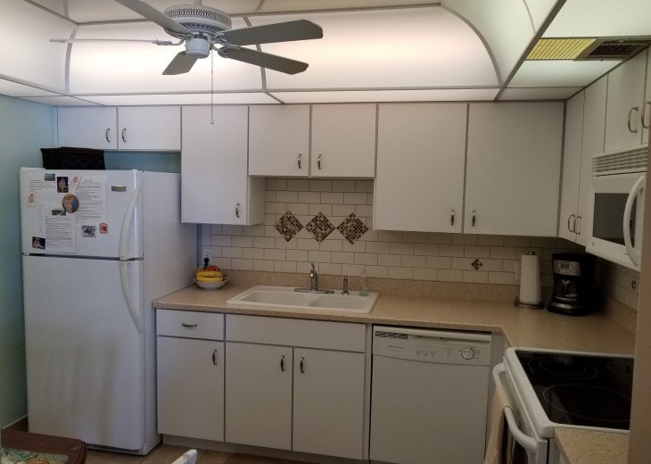 L Shaped Kitchen w Tile Back Splash, Fridge