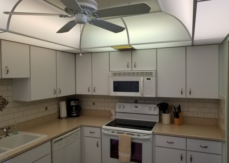 L Shaped Kitchen w California Ceiling, Stove, Microwave, Dishwasher