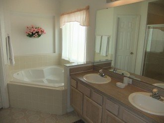 One of 3 bathrooms. This one with bath tub and walk in shower