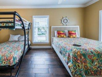 kid bunk room with full bath